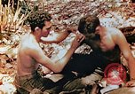 Image of Marine renders first aid to wounded buddy Saipan Northern Mariana Islands, 1944, second 5 stock footage video 65675028048
