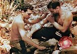 Image of Marine renders first aid to wounded buddy Saipan Northern Mariana Islands, 1944, second 8 stock footage video 65675028048
