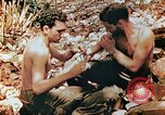 Image of Marine renders first aid to wounded buddy Saipan Northern Mariana Islands, 1944, second 9 stock footage video 65675028048