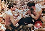Image of Marine renders first aid to wounded buddy Saipan Northern Mariana Islands, 1944, second 10 stock footage video 65675028048