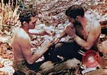 Image of Marine renders first aid to wounded buddy Saipan Northern Mariana Islands, 1944, second 11 stock footage video 65675028048