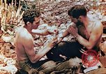 Image of Marine renders first aid to wounded buddy Saipan Northern Mariana Islands, 1944, second 12 stock footage video 65675028048