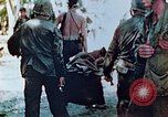 Image of Evacuating a wounded U.S. marine Saipan Northern Mariana Islands, 1944, second 6 stock footage video 65675028049