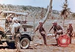 Image of Evacuating a wounded U.S. marine Saipan Northern Mariana Islands, 1944, second 9 stock footage video 65675028049
