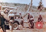 Image of Evacuating a wounded U.S. marine Saipan Northern Mariana Islands, 1944, second 10 stock footage video 65675028049
