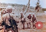 Image of Evacuating a wounded U.S. marine Saipan Northern Mariana Islands, 1944, second 11 stock footage video 65675028049
