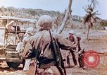 Image of Evacuating a wounded U.S. marine Saipan Northern Mariana Islands, 1944, second 12 stock footage video 65675028049