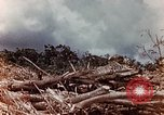 Image of U.S. marine throws hand grenade Saipan Northern Mariana Islands, 1944, second 6 stock footage video 65675028058