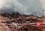 Image of U.S. marine throws hand grenade Saipan Northern Mariana Islands, 1944, second 7 stock footage video 65675028058