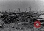 Image of wreckage in field Europe, 1918, second 4 stock footage video 65675028113