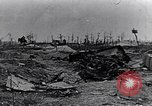 Image of wreckage in field Europe, 1918, second 9 stock footage video 65675028113