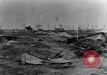 Image of wreckage in field Europe, 1918, second 10 stock footage video 65675028113