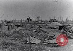 Image of wreckage in field Europe, 1918, second 11 stock footage video 65675028113