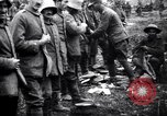 Image of British officer searches several German prisoners France, 1916, second 5 stock footage video 65675028133