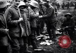 Image of British officer searches several German prisoners France, 1916, second 6 stock footage video 65675028133