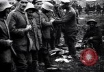 Image of British officer searches several German prisoners France, 1916, second 7 stock footage video 65675028133