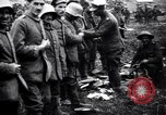Image of British officer searches several German prisoners France, 1916, second 8 stock footage video 65675028133