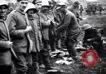 Image of British officer searches several German prisoners France, 1916, second 10 stock footage video 65675028133