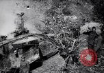 Image of British Mark I tank (male) followed by Allied troops France, 1916, second 7 stock footage video 65675028139
