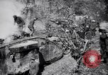 Image of British Mark I tank (male) followed by Allied troops France, 1916, second 10 stock footage video 65675028139