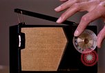 Image of transistor radio United States USA, 1961, second 11 stock footage video 65675028236