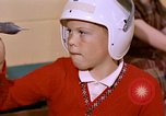 Image of American boy United States USA, 1961, second 12 stock footage video 65675028246