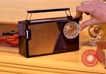 Image of General Electric transistor radio United States USA, 1961, second 9 stock footage video 65675028247