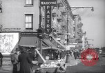 Image of Street scene in Little Italy New York City USA, 1941, second 7 stock footage video 65675028562
