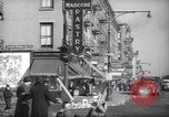 Image of Street scene in Little Italy New York City USA, 1941, second 12 stock footage video 65675028562