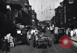 Image of Busy street in a city India, 1953, second 3 stock footage video 65675028598
