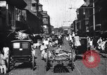 Image of Busy street in a city India, 1953, second 4 stock footage video 65675028598