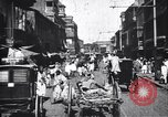 Image of Busy street in a city India, 1953, second 5 stock footage video 65675028598