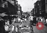 Image of Busy street in a city India, 1953, second 6 stock footage video 65675028598