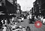 Image of Busy street in a city India, 1953, second 7 stock footage video 65675028598