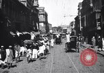 Image of Busy street in a city India, 1953, second 9 stock footage video 65675028598