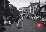 Image of Busy street in a city India, 1953, second 11 stock footage video 65675028598