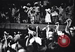 Image of People watching Flamingos in a zoo India, 1953, second 1 stock footage video 65675028600