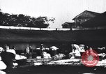 Image of Dhobis working at a Dhobi Ghat India, 1953, second 7 stock footage video 65675028601