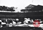 Image of Dhobis working at a Dhobi Ghat India, 1953, second 8 stock footage video 65675028601