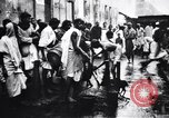 Image of Indian men preparing Temple offerings Calcutta India, 1953, second 4 stock footage video 65675028602
