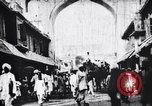 Image of Camels, bullock carts and an elephant moving in a street India, 1953, second 1 stock footage video 65675028604