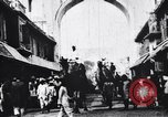 Image of Camels, bullock carts and an elephant moving in a street India, 1953, second 8 stock footage video 65675028604