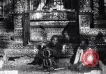 Image of Man sings and plays a saranqi at a temple India, 1953, second 1 stock footage video 65675028606