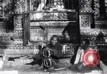 Image of Man sings and plays a saranqi at a temple India, 1953, second 3 stock footage video 65675028606