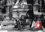 Image of Man sings and plays a saranqi at a temple India, 1953, second 4 stock footage video 65675028606