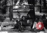 Image of Man sings and plays a saranqi at a temple India, 1953, second 5 stock footage video 65675028606