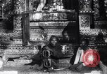 Image of Man sings and plays a saranqi at a temple India, 1953, second 6 stock footage video 65675028606
