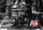 Image of Man sings and plays a saranqi at a temple India, 1953, second 7 stock footage video 65675028606
