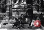 Image of Man sings and plays a saranqi at a temple India, 1953, second 8 stock footage video 65675028606