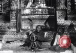 Image of Man sings and plays a saranqi at a temple India, 1953, second 9 stock footage video 65675028606